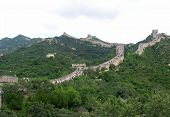 View of crowded Great Wall of China with green surrounding nature poster