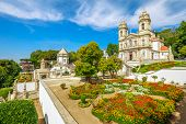 Historic Church of Bom Jesus do Monte and her public garden. Tenoes, Braga. The Basilica is a popular landmark and pilgrimage site in northern Portugal. Aerial landscape on the top of Braga mountain. poster