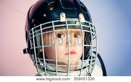 Boy Cute Child Wear Hockey Helmet Close Up. Safety And Protection. Protective Grid On Face. Sport Eq