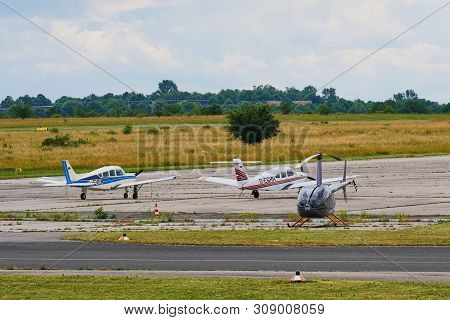 Mainz, Germany - June 20, 2019: Two Microlight Aircrafts And An Ultralight Helicopter On A Small Air