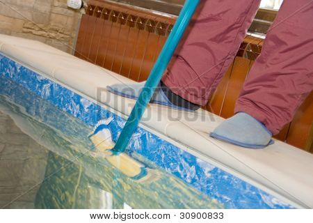 Cleaning a pool. Pool guy