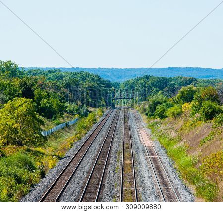 Burlington, Canada - September 23, 2018: Multiple Railway Tracks Head West Through Forested Area.