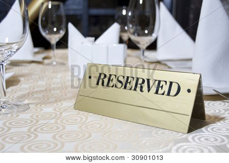 Reserved sign on the table