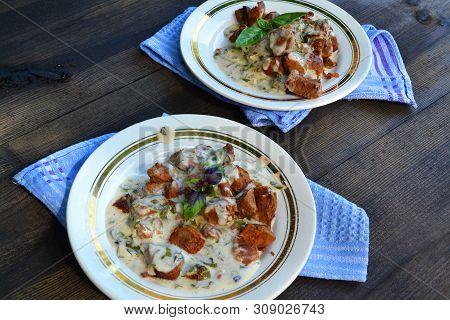 Russian Cuisine: Stewed Roe Deer, Goulash Of Wildfowl On Black Wooden Table
