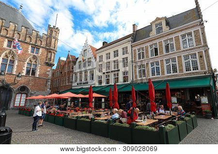 Bruges,belgium-may 27, 2019 : The Traditional Flemish Cafe De Vier Winden Located On Markt Of Bruges