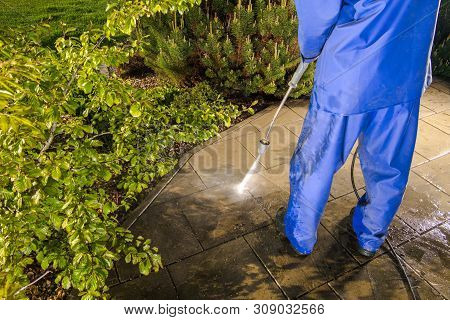 Power Washing Backyard Garden Paths. Pressure Washer Cleaning.