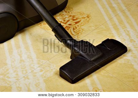 Carpet vacuuming, sanitary restoration of cleanliness from garbage. Maintaining safe hygiene cleanliness, effective removal of dirt in industrial, commercial, hygiene in the home and for aesthetics. poster