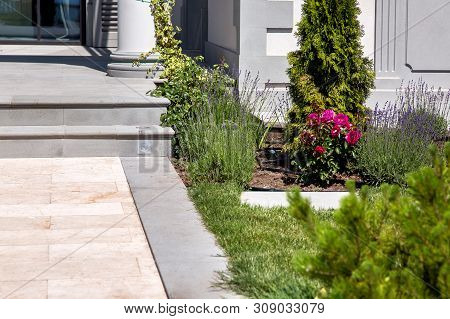 Marble Walkway With Flowerbed At The Entrance To The House With Stone Steps On A Sunny Summer Day, D