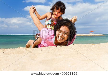 Asian Mother And Child Fun Play At The Beach