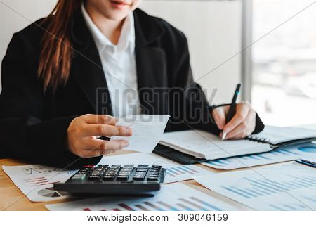 Business Woman  Accounting Financial Investment On Calculator Cost Economic Business And Market