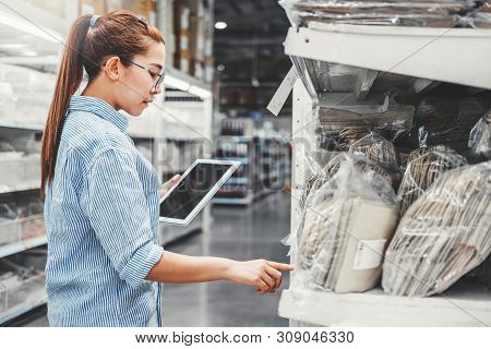 Asian Woman Worker Working With Digital Tablet Checking Boxes Logistic Import And Export Supplies Pa