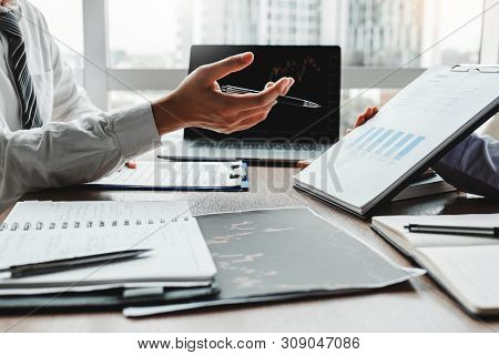 Business Team Meeting Investment And Entrepreneur Trading Stock Market And Exchange Discussing And A
