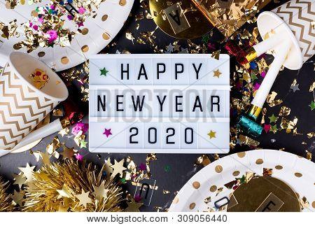 Happy New Year 2020 On Light Box With Party Cup,party Blower,tinsel,confetti.fun Celebrate Holiday P