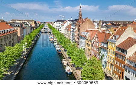 Beautiful aerial view of Copenhagen skyline from above, Nyhavn historical pier port and canal with color buildings and boats in the old town of Copenhagen, Denmark poster