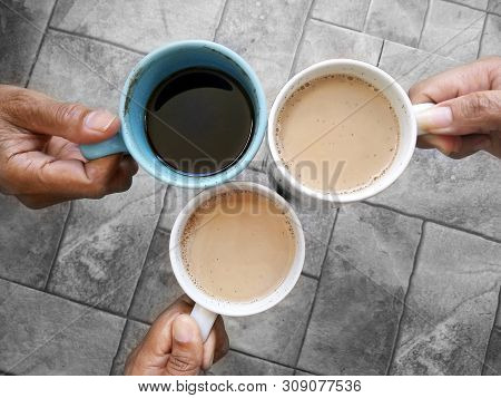 Cheers Coffee. Three Cups Of Coffee Hold By Hands. 3 Best Friends Making Cheers Coffee. Coffee Break