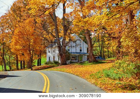 Highway at sunny autumn day in Vermont, USA