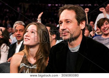 NEW YORK - MAR 7: David Duchovny (R) and daughter Madelaine attend the game between the New York Knicks and the Oklahoma City Thunder at Madison Square Garden on March 7, 2013 in New York City.