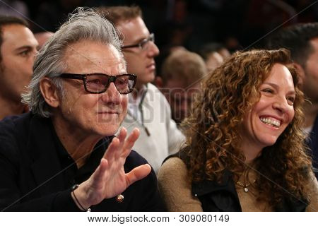 NEW YORK - FEB 10: Harvey Keitel (L) and wife Daphna Kastner attend the game between the New York Knicks and the Los Angeles Clippers at Madison Square Garden on February 10, 2013 in New York City.