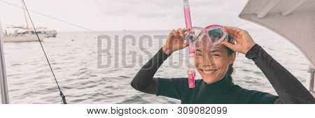 Snorkel mask Asian woman tourist getting ready for snorkeling activity tour from boat banner panorama.