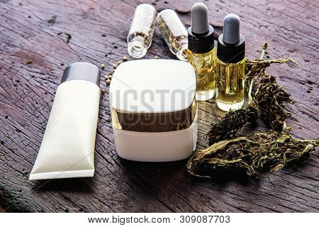 Medical Marijuana Concept, Hemp Cannabis Natural Products  with Lotion Black Wooden Table Top