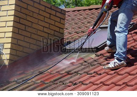 House Roof Cleaning With Pressure Tool. Moss Removing With Water. Tile Washing With Professional Equ