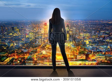 Young Woman Looking Over The City Of London Business And Banking Area With Skyscrapers At Sunset. Fu