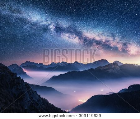 Milky Way Over Mountains In Fog At Night In Summer. Landscape With Foggy Alpine Mountain Valley, Pur