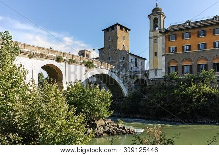 Rome, Italy - June 22, 2017: Amazing View Of Tiber River And Pons Fabricius In City Of Rome, Italy