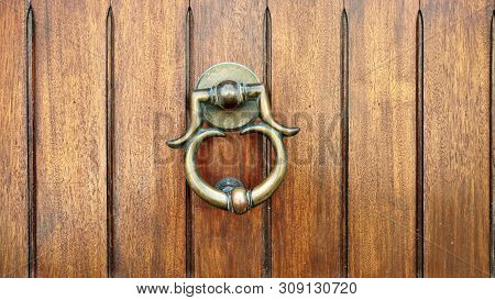 Vintage Bronze Knob With Knocking Ring. Closeup On Vintage Bronze Door Knob With Knocking Ring On Br