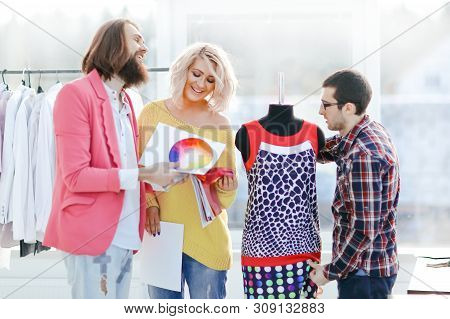 Creative Couturiers Discuss The Palette, Standing In A Creative Studio