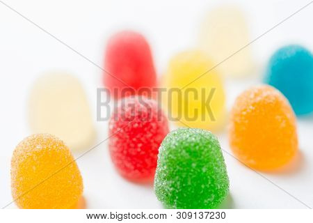 Colorful Yellow Red Orange Green Gummy Jelly Candies Coated With Sugar On White Background. Kids Bir
