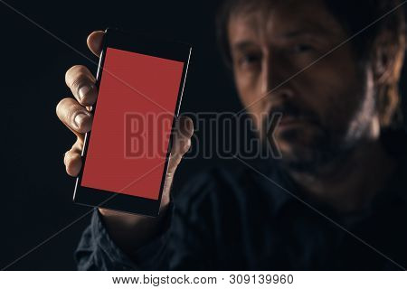 Man Holding Mockup Smartphone. Modern Contemporary Mobile Phone With Blank Screen In Male Hand.