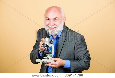 Molecular Biology Phd Projects. Mature Man Formal Suit With Microscope. Doctoral Work And Postdoctor