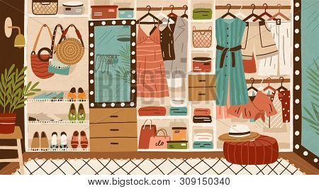 Inner Space Of Closet Or Wardrobe. Female Clothes Or Apparel Hanging On Hanger, Garment Rack Or Rail