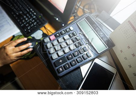Business Accounting Concept, Business Woman Using Calculator With Computer Laptop, Budget And Loan P