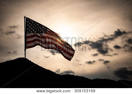 The Concept, Labor Day: Flag Of The United States Against The Sky And Light Of The Sunset