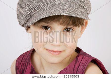 Pretty Girl In A Gray Woolen Cap
