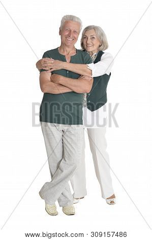 Portrait Of Happy Senior Couple Embracing Isolated