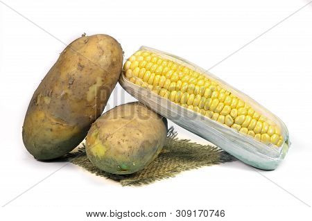 Sweetcorn Cob And Potatoes On A Square Of Hessian