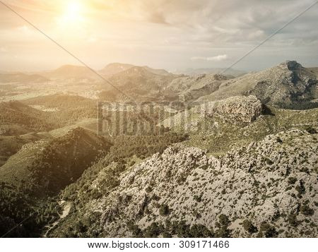 Beautiful birdeye view on forest in mountains at sunny day. Palme de Mallorca island. Travell, jorney, island, freedom, concept.