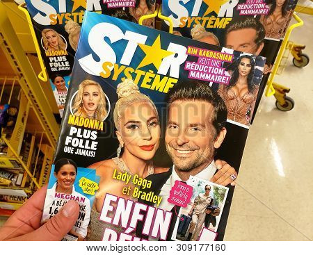 Montreal, Canada - June 20, 2019: A Hand Holding Star Magazine With Lady Gaga And Bradley Cooper On