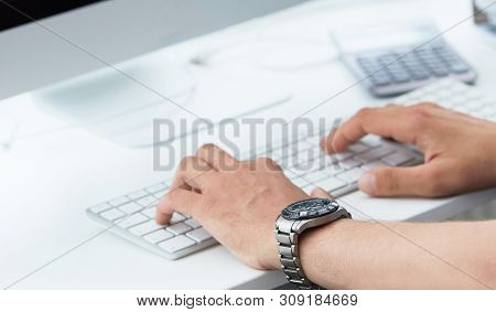 Businessman Using Computer Keyboard. Close Up Of Male Hands Typing On Computer Keyboard. Blogger, Jo