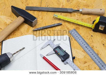 The Image Shows Different Measuring Tools And Tools On A Wooden Table