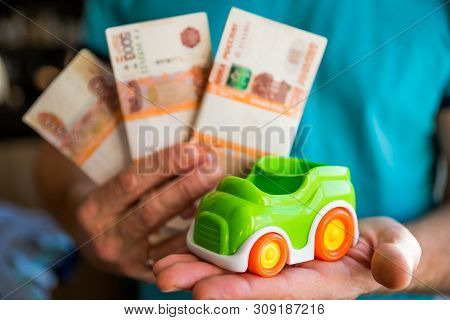 Car And Money In Male Hands, Car Loan Concept, Saving Money For Car Concept, Trade Car For Cash Conc