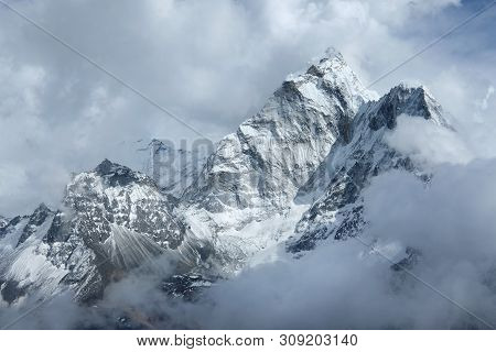 View Of Foggy Ama Dablam In Clouds On The Way To Everest Base Camp, Nepal