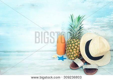 Summer Concept Stillife - Ripe Pineapple, Straw Hat, Flip-flops And A Bottle Of Multivitamin Juice I