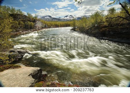 Long Exposure Shot Of The Stream Abiskojakka In Abisko, Norrbotten, Sweden