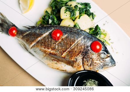 Fresh Grilled Dorade Fish On The Plate