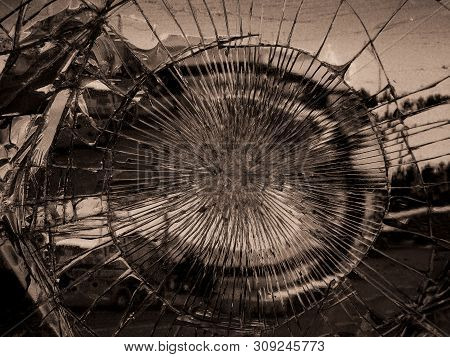 Broken Mirror Glass In Which Is Reflected The City. Monochrome Variant. Dark Colors Give A Gloomy, M