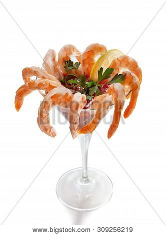 Shrimp Cocktail With Sauce In A Martini Glass On White Background.